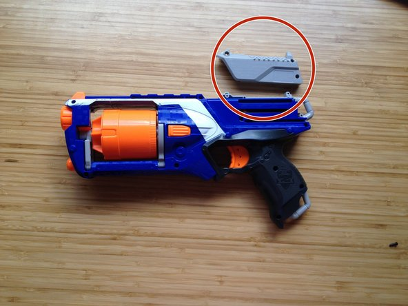 Remember to remove the grey part of the reloader that is not attached to the gun.