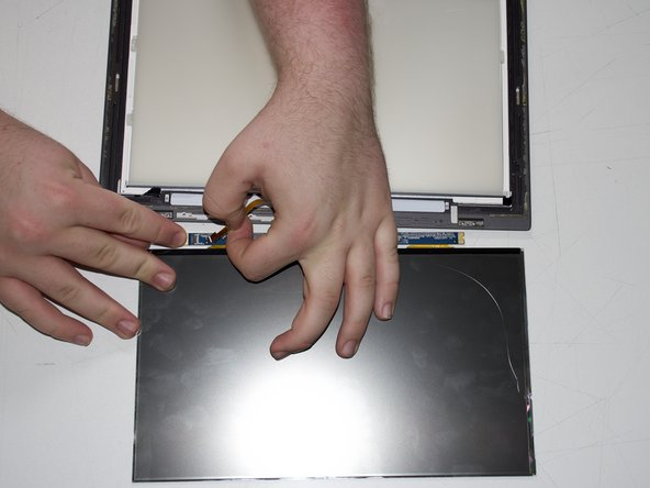 Remove the cable connecting the screen housing to the control board by pulling the cable.