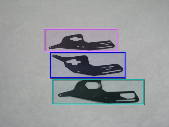 To replace the shutter pieces in the camera, first make sure they are in the proper order.