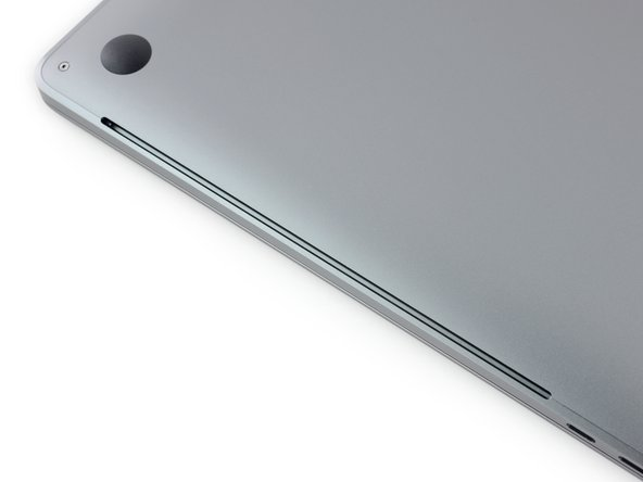 Image 3/3: Just like the [https://www.ifixit.com/Teardown/MacBook+Pro+15-Inch+Retina+Display+Mid+2012+Teardown/9462#s36188|previous MBP line|new_window=true], there are long air intake vents under the left and right sides. If this computer is anything like its [https://www.ifixit.com/Teardown/MacBook+Pro+13-Inch+Touch+Bar+Teardown/73480#s148019|little brother|new_window=true], these vents should serve double-duty as speaker outlets.