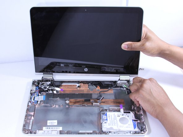 Gently pull the display away from the base panel to unhinge.