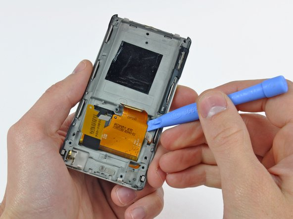 Use a Zune opening tool to peel the digitizer and display ribbon cables off the foam tape securing them to the inner chassis.