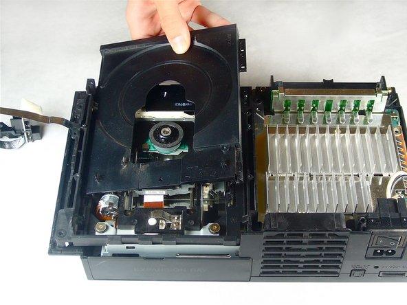 Image 2/2: Lift and remove the optical disc drive straight up out of the bottom case.