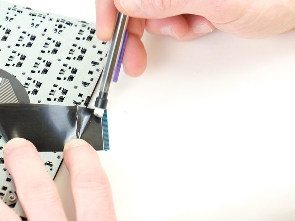 Using your pencil's eraser, gently clean the contact points on the ribbon cable.