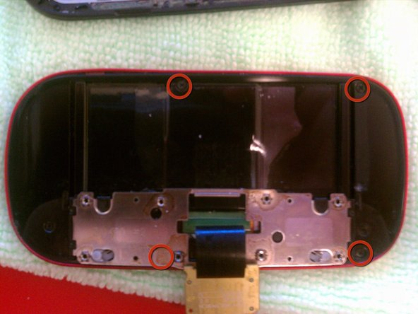 Remove the 4 screw the holds the slider to the phone assembly