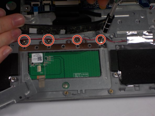 Remove the last four screws that hold the touch pad in place.