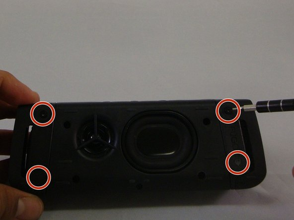 Image 1/3: Using the plastic opening tool, you will be able to wedge back face of speaker off.