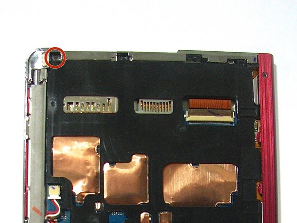 Using the same screwdriver, remove the 1.4 mm screw from the back of the device.