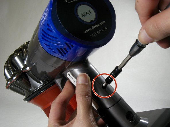 Locate the screw on the device handle.