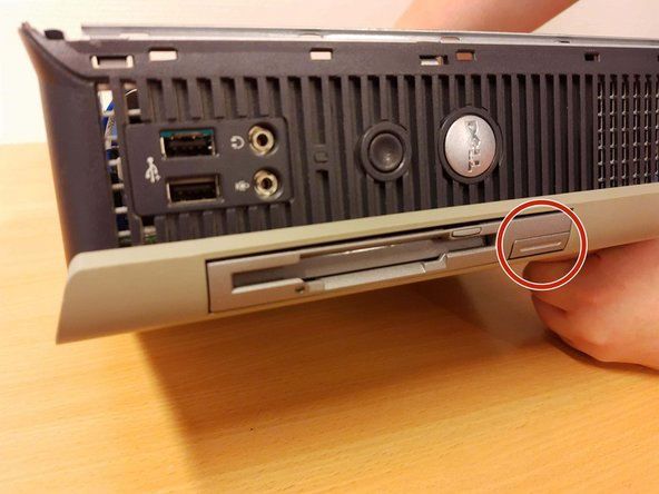 Remove the floppy drive by pressing the marked knob.