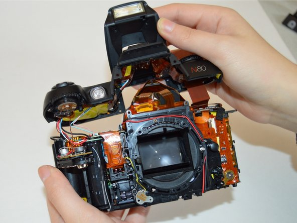 Image 1/1: Don't pull the top section off too hard or the wire and ribbon within the camera may disconnect.