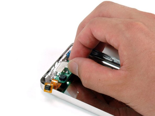 Grasp the headphone jack board and lift it out of the iPod.