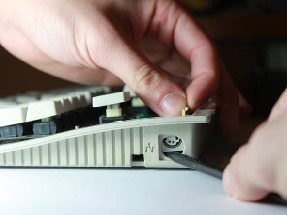 Image 2/3: Don't just shove up the port - it's delicate. Guide it up with your fingers slowly.