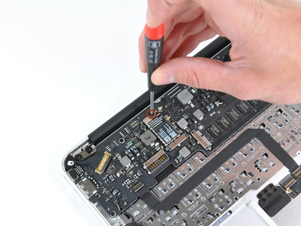 With the turn of a screw, out comes the wireless board.