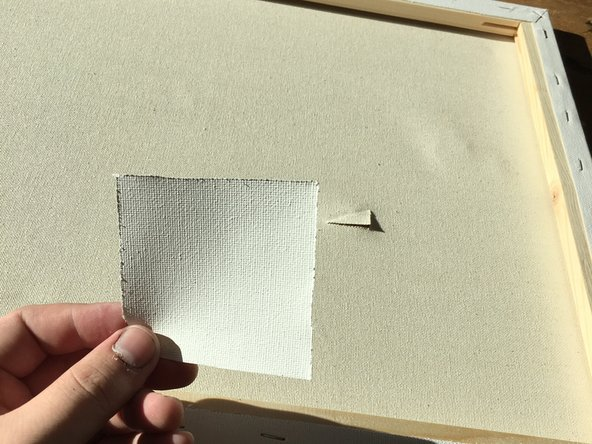 Once you have your square of canvas, ensure the size is correct for the tear you are repairing. Round the edges off with your scissors. This will create an evenly balanced edge which will remove unwanted corners and points that can arise after the gluing process.