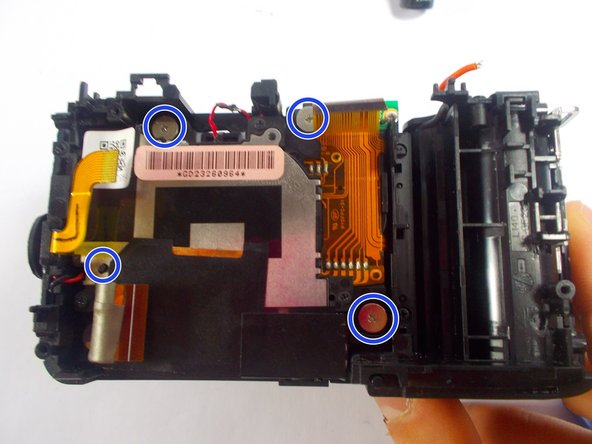 Remove the four larger silver plated screws placed on the inside of the lens.