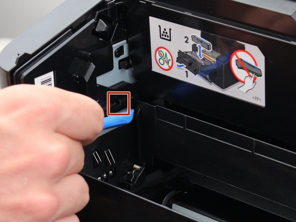 There are 2 locks on the inner walls of the sides of the printer which need to be removed in order to have access to the toner drawer.