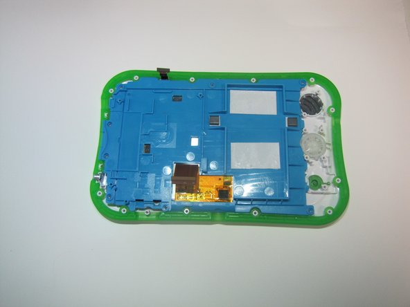 Along the side of the blue panel are 6 screws. Unscrew each of the screws with a Phillips #1 screwdriver.