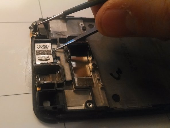Image 1/3: Remove the power button by Peeling away the small amount of tape holding it to the screen assembly.