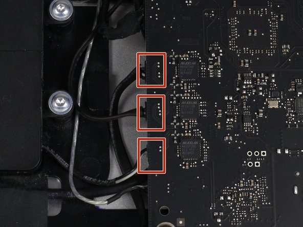 To the right of the middle speaker is the logic board. Here is where the three speakers in the display are connected and need to be removed.