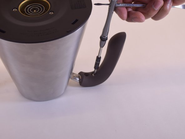 Use a Phillips-Head (PH1) screwdriver to loosen the two screws that attach the handle to the pot.