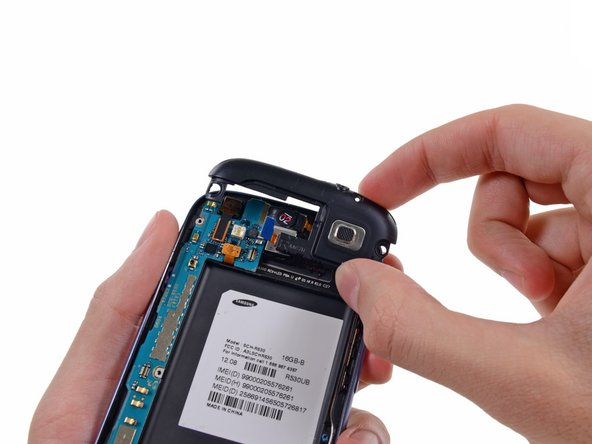 Lift the headphone jack/speaker assembly out of the Galaxy S III.
