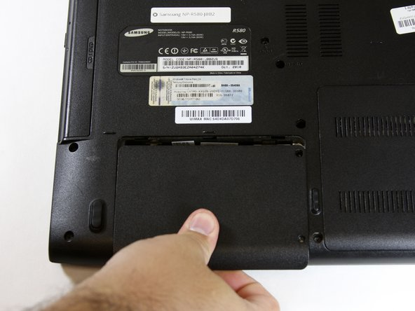 Pull down while applying pressure to release HDD back plate cover and then lift the cover upward.