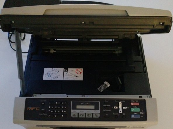 Completely lift up scanner portion of printer and detach visible USB chord.