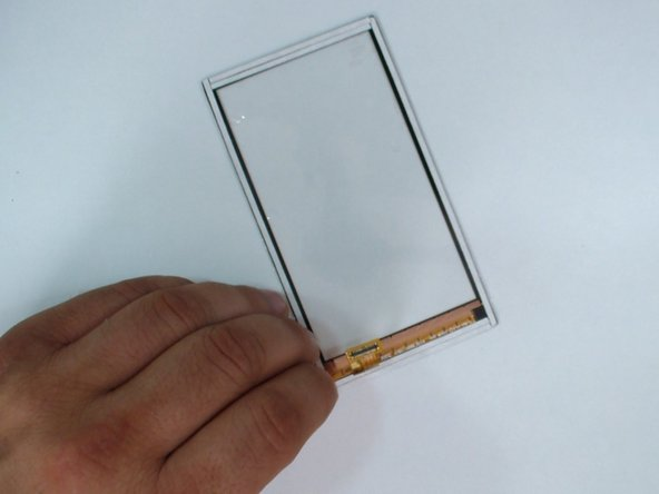 Install a new adhesive tape on the digitizer glass.