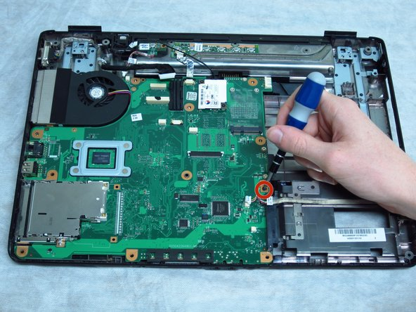 Use a Phillips #1 screwdriver to remove the 6-mm screw near the hard drive.