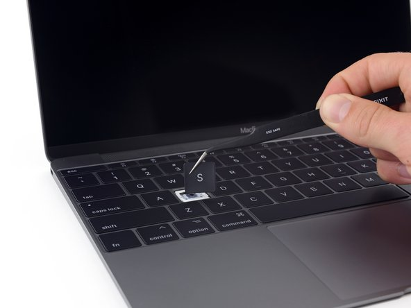 "Image 1/3: Comparing the space gray ""new"" keyboard to the rose gold MacBook of yesteryear, we can see:"