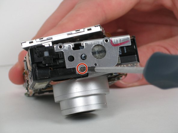 Remove the one 2.7 mm Phillips screw from the left side of the camera.