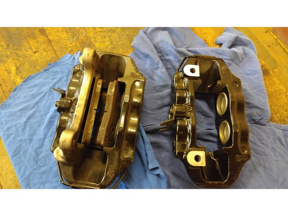 Image 2/3: Remove the pads via a punch & small hammer to remove the brake pads retention pins.