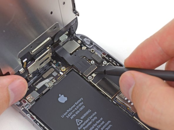 Spudger being used in an iPhone repair