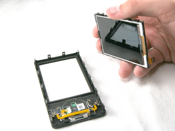 Image 2/2: Screen Replacement Only:  After fixing the original screen or purchasing a new one, simply place the screen back into black frame and re-install the cables in the reverse order of this guide.