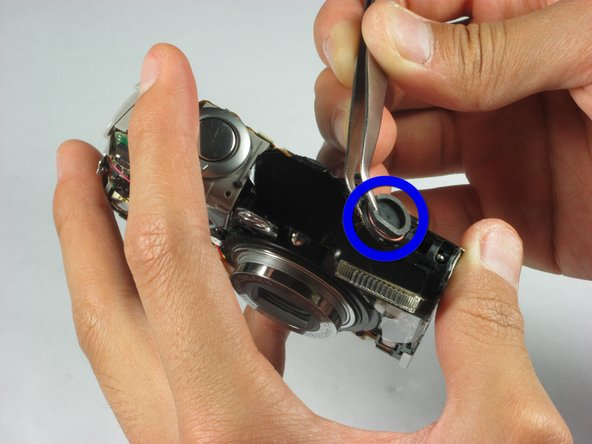 Image 1/2: Next use the tweezers to carefully remove the speaker cable off its respective holders.