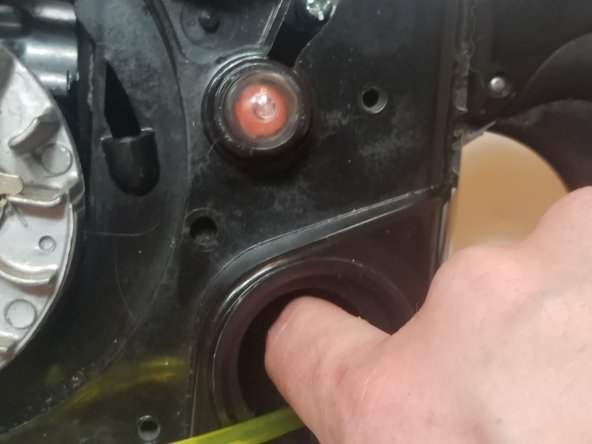 Cut the smaller diameter fuel line (fuel return line) and push it into the gas tank