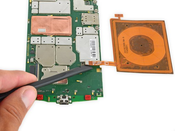 Use the flat end of a spudger to disconnect the wireless charging coil connector from the motherboard.