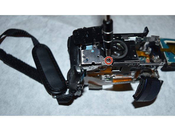 Image 1/2: Once the screw is removed, the speaker can be separated from the camcorder