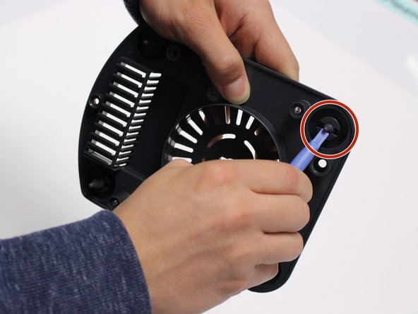 Push the stopper on the  suction cup foot through the bottom panel using the iFixit plastic opening tool.