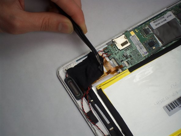 If not already done, remove the black tape holding the wires down.