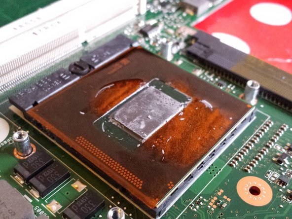 Scratch the old thermal paste from the surface of the CPU with a  pick or a plastic opening tool .