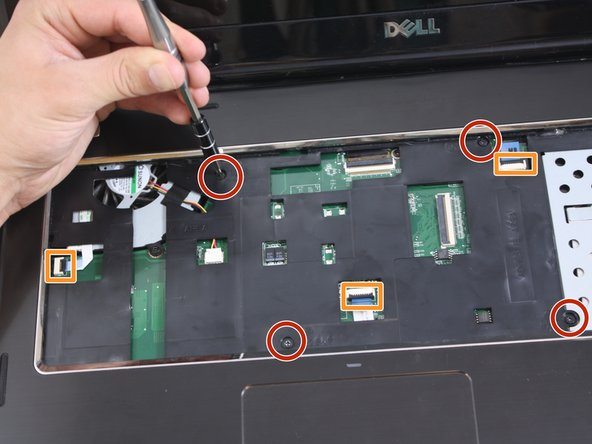 Use a Phillips #0 screwdriver to unscrew the four 5mm screws from the palmrest.