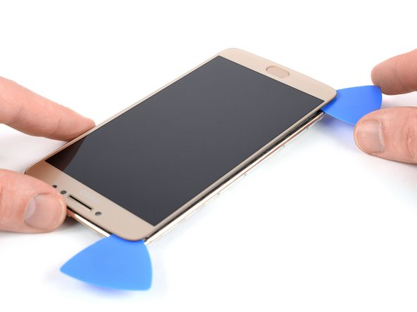 Repeat the previous heating and cutting procedure on the left edge of the phone to cut the remaining adhesive.