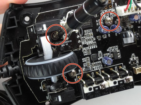 Use a Phillips #0 screwdriver to remove three 5.5 mm screws.