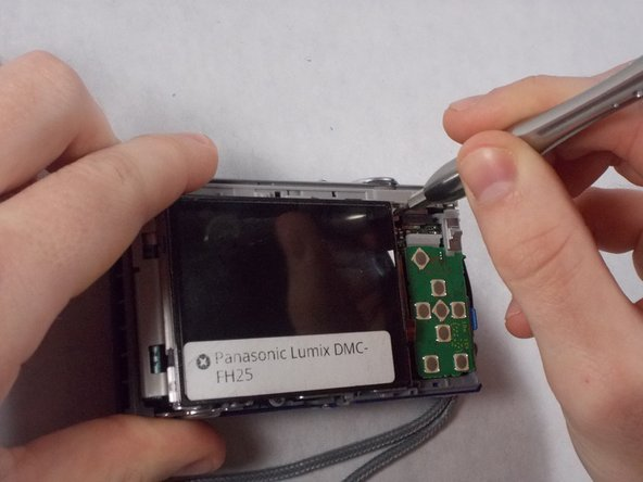 Image 2/3: Lift the screen, being careful not to tear the ribbon cables on the right side.