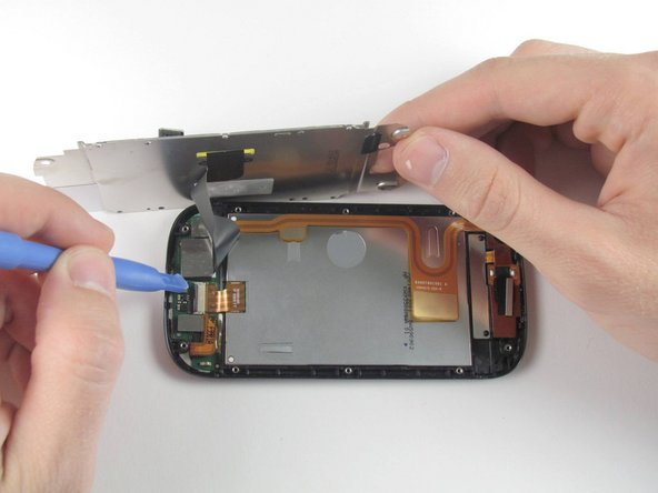 Image 1/2: Separate the display flex cable from the LCD cover plate.