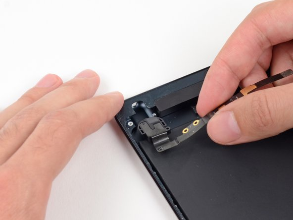 Image 2/2: Pull the headphone jack straight out of its recess in the rear case.