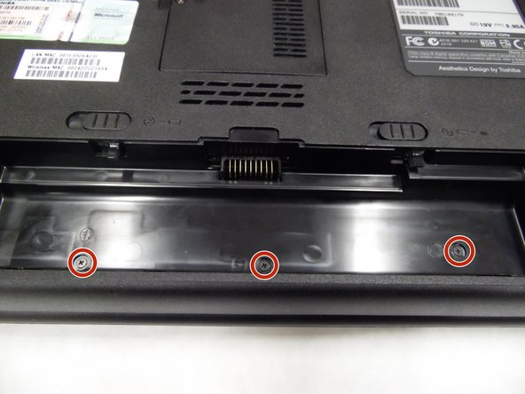 Once the battery is removed, locate and unscrew the 3.2 mm PH1000 Phillips head screws that are underneath the battery.