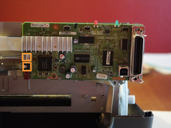 Image 2/2: Two cables remain connected to the logic board.